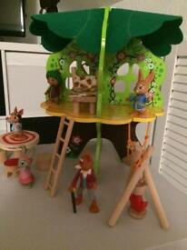 Peter rabbit figures and tree house brand new