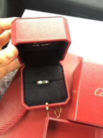 Authentic 18 karat white gold Cartier wedding band