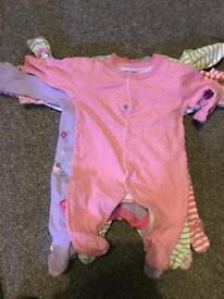 6 newborn sleepsuits for sale
