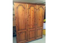 Polished solid pine wardrobe