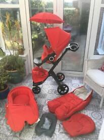 Stokke Xplory V5 Black edition chassis in Red with extras