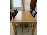 6ft real oak dining table and 6 brown leather chairs