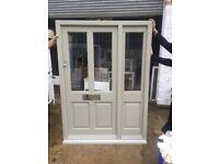 Elegant wooden front door with side panel