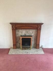 Electric Fire with Granite hearth and Surround, and wooden mantle piece