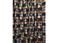 John Lewis curtains, navy background with shades of blue & brown dot design.