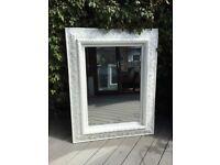 Large wooden framed white mirror