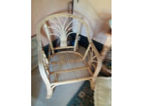 Rattan armchair with new cushions - for conservatory or dining room use