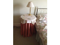 Two circular bedside tables