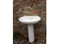 White bathroom sink with pedestal
