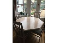 hexagonal dining room table with 4 chairs