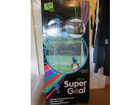TP36 Super Goal with 5-hole goal trainer 7ft x 5ft. Comes with ground stakes. Brand new, boxed