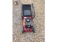 Petrol lawnmower red and black