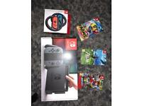 NINTENDO SWITCH GREY WITH 3 GAMES AND JOY CON STEERING WHEELS
