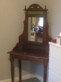 Beautiful carved wood vanity with mirror