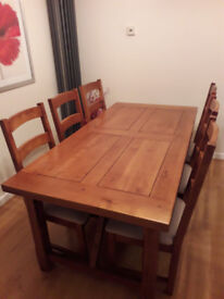 dark oak rectangular dining table with 6 chairs