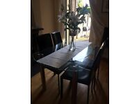 Glass Table with four leather chairs from NEXT - £95