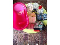Baby Bathtub and some baby clothes