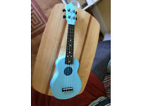 Blue plastic kids/beach ukulele