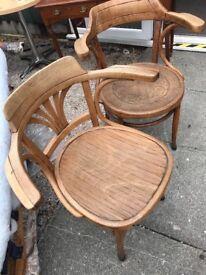Antique bent wood captains chairs