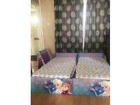 Two Frozen Toddler Beds and Bookcase