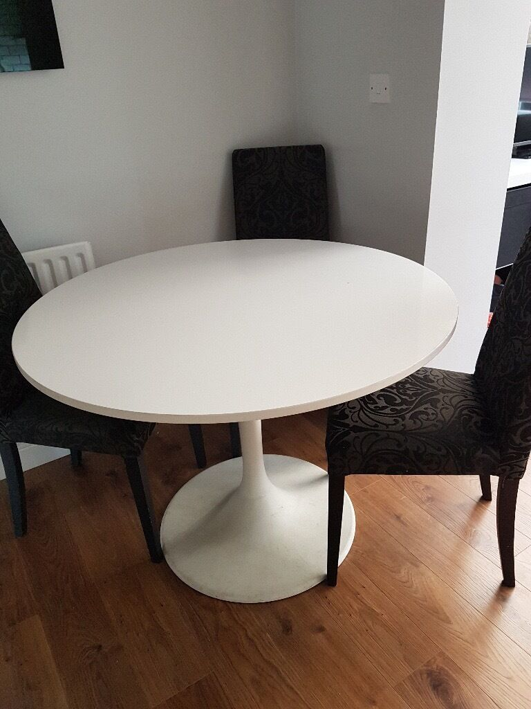 Ikea docksta round white dining table 6 next black and - Dining table and fabric chairs ...