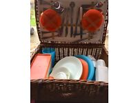 Retro Vintage Picnic Basket with assorted contents.
