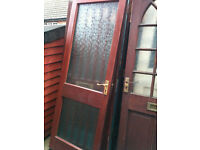 Exterior hardwood door with 2 patterned glass panels