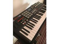 Akai MPK49 midi keyboard controller with high end Diago Showman hard case