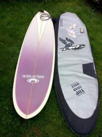 7. 2 surfboard with fins and leash and surfboard bag