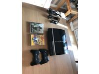 PlayStation 3, with controllers and games