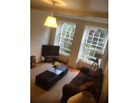 3 seater brown sofa and cuddle swivel chair