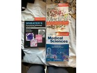 3 different medical school books, perfect for a new medical student