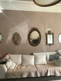 Large oval ornate antique mirror