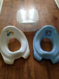 Two toddler toilet seats and a toddler step