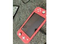 Coral Nintendo Switch with charger & game