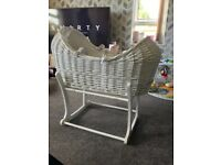 White wicker Moses basket with rocker