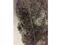 Very thick grey shaggy rug