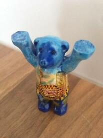 Small blue bear mascot figurine toy