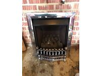 Silver chrome colour gas fire place and with silver chrome guard and frame trim