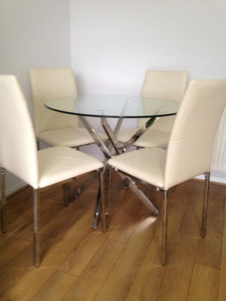 Yakoe glass round dining table set and 4 chairs