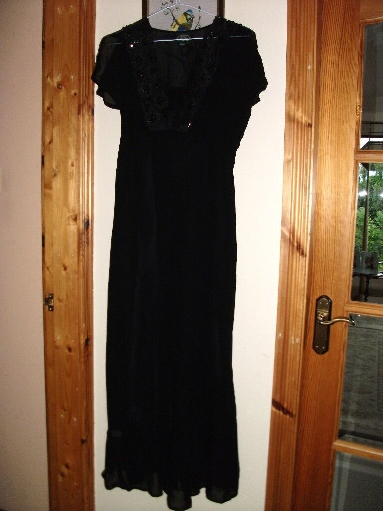 """Black """"Laura Ashley"""" dress, size 12. Good condition. Formal wear for partiesin Coleraine, County LondonderryGumtree - Black """"Laura Ashley"""" dress. Size 12, 130 centimetres long. Black sequins and beads on neckline. Worn very few times, in good condition. Formal wear, suitable for parties or weddings"""