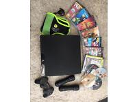 Sony PlayStation PS3 with games and controllers