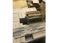 Grey & white splitface tiles. 36 x 11 cm. £35 SQM.