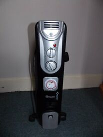 Electric Oil Filled Radiator C/W Timer excellent condion colour Black & Silver