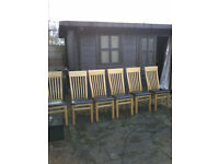 Solid oak dinig ( extendable ) table and six chairs
