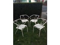 Set of 4 vintage French cast iron garden chairs