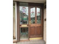 Hardwood door with stained glass units.
