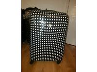 Black and white checkered suitcase