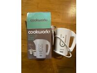 Small white travel kettle