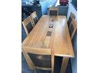 Solid Oak Dinning Room Table with 6 matching chairs in brown leather